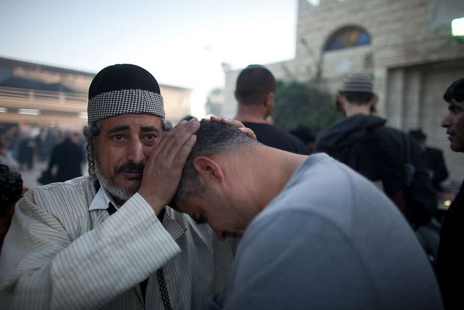 NETIVOT, ISRAEL - JANUARY 15: (ISRAEL OUT) Jewish men pray at the grave of Rabbi Yisrael Abuhatzera, known as the sage Baba Sali, on January 15, 2013 in the southern Israeli town of Netivot, Israel. Thousands of Jews, mainly of Moroccan origin, gathered to pray and hold festivities at the tomb of the respected rabbi who was known as a miracle maker by religious Jews. (Photo by Uriel Sinai/Getty Images) Photo: Uriel Sinai, Getty Images