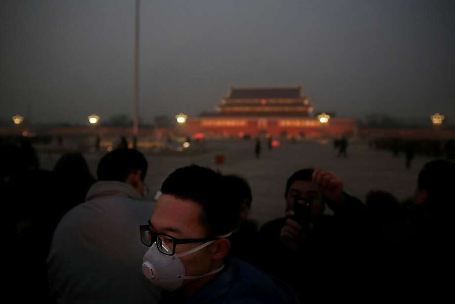 BEIJING, CHINA - JANUARY 13:  A tourist wearing the mask visits the Tiananmen Square at dangerous levels of air pollution on January 13, 2013 in Beijing, China.  (Photo by Feng Li/Getty Images) Photo: Feng Li, Getty Images
