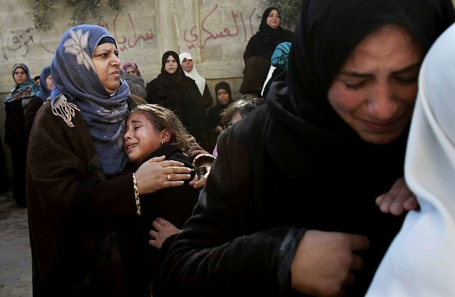 Palestinians women mourn during the funeral of Palestinian farmer Moustafa Abu Jarad in Beit Lahiya, northern Gaza Strip, Tuesday, Jan. 15, 2013. According to Palestinian medical official Ashraf al-Kidra, the farmer was shot dead by Israeli troops. The Israeli military said in initial investigation disclosed it was not behind the shooting. (AP Photo/Adel Hana) Photo: Adel Hana, Associated Press