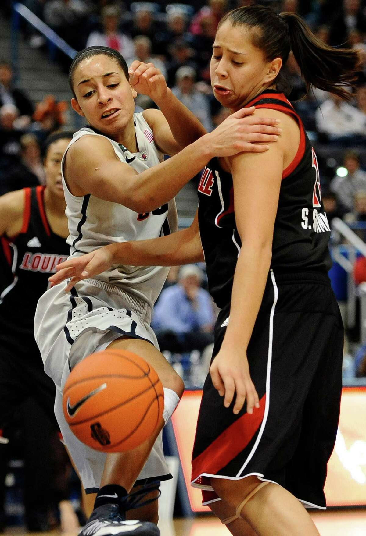 Connecticut's Bria Hartley, left, and Louisville's Shoni Schimmel, right, chase a loose ball during the second half of an NCAA college basketball game in Hartford, Conn., Tuesday, Jan. 15, 2013. (AP Photo/Jessica Hill)