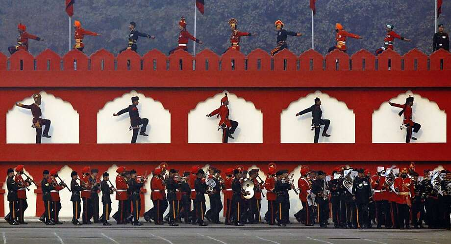 "An Indian army band performs, as soldiers march during a parade to mark Indian Army Day, an annual event honoring the military, in New Delhi, India, Tuesday, Jan. 15, 2013. India's relations with archrival Pakistan ""cannot be business as usual"" in the wake of a spate of attacks in Kashmir, Prime Minister Manmohan Singh said Tuesday in a statement that threatens to ratchet up tensions in the wake of the Himalayan violence. (AP Photo/Tsering Topgyal) Photo: Tsering Topgyal, Associated Press"