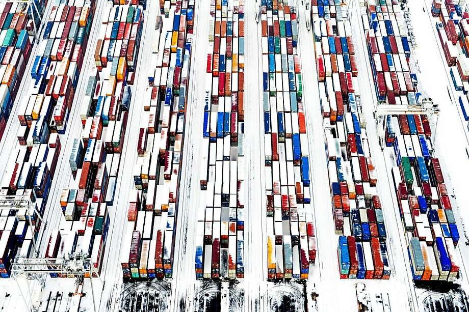 Snow covered containers create a pattern in the port of Rotterdam, The Netherlands, on January 15, 2013. Most of Holland is covered by a thick white layer after  one night of snow. AFP PHOTO:ANP ROBIN UTRECHT netherlands out - ROBIN UTRECHT/AFP/Getty Images Photo: Robin Utrecht, AFP/Getty Images