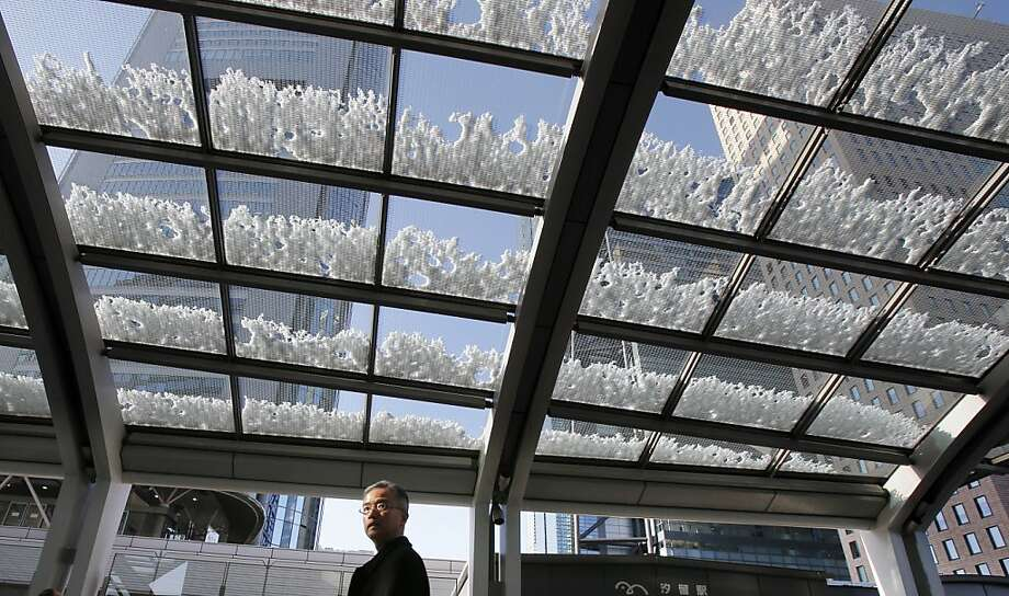 A man walks through a corridor where snow remains from Monday's storm, in Tokyo, Tuesday, Jan. 15, 2013. In the season's first snowfall in the Japanese capital, about 8 centimeters (3 inches) of snow fell in central Tokyo and around Narita on Monday.  (AP Photo/Koji Sasahara) Photo: Koji Sasahara, Associated Press