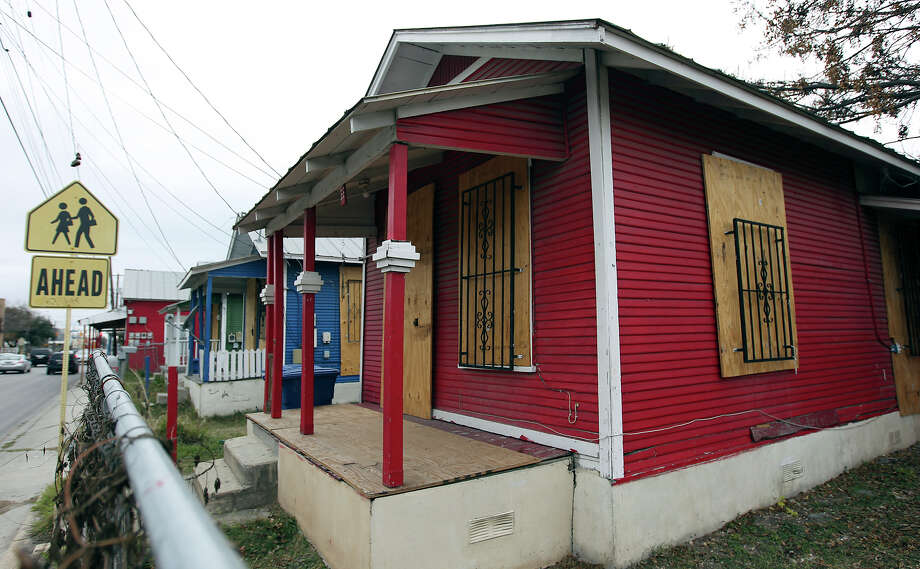 """Shotgun"" houses on the 1100 block of Guadalupe on Tuesday, Jan. 15, 2013. The buildings are among 24 Westside properties set for landmark designation by the Historic and Design Review Commission. Photo: Kin Man Hui, San Antonio Express-News / © 2012 San Antonio Express-News"