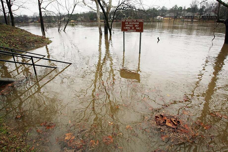 A pier at the Park at Manderson Landing is submerged by floodwaters from the Black Warrior River in Tuscaloosa, Ala., on Tuesday, Jan. 15, 2013.  Since Sunday, about three inches of rain had fallen in the area, according to the National Weather Service in Birmingham, Ala. (AP Photo/The Tuscaloosa News, Michelle Lepianka Carter) Photo: Michelle Lepianka Carter, Associated Press