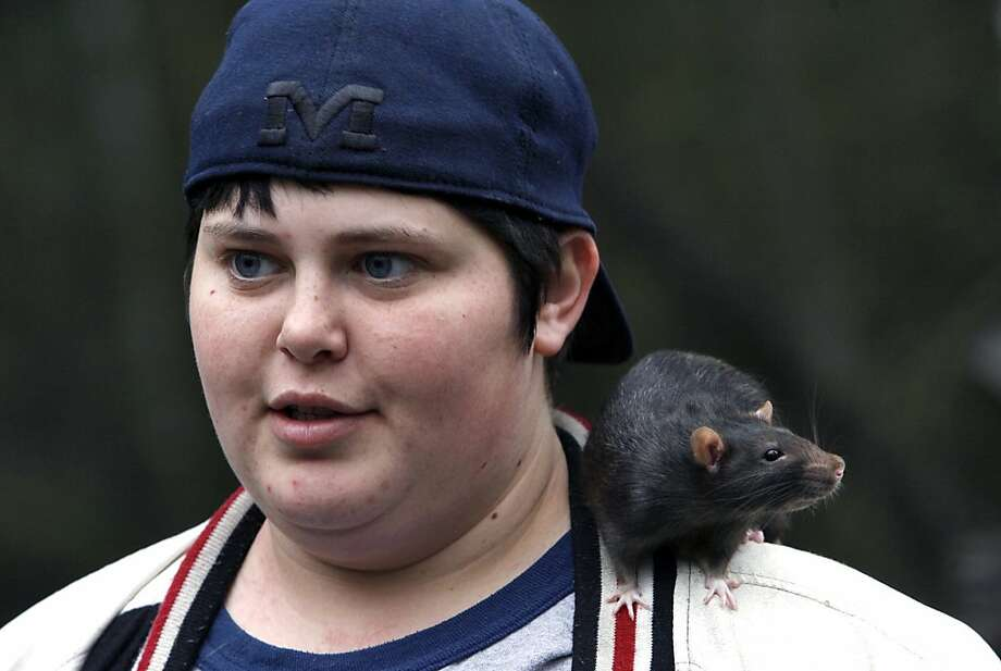 "In this Jan. 14, 2013, photo, Amelia ""Vegas"" Eichler and her pet rat, Scabbers, visit the homeless camp of Gary Rayburn in Biloxi, Miss. Gary Rayburn has spent two years living and distributing necessities to other homeless but his idyllic campsite is coming to an end. The homeless veteran has been told he has to move because of a neighbor's complaint and a code-enforcement violation, both of which apparently involved a different campsite nearby. (AP Photo/The Sun Herald, Tim Isbell) TV OUT; MANDATORY CREDIT: MISSISSIPPI PRESS OUT; LOCAL TV OUT WLOX, LOCAL ONLINE OUT; GULFLIVE.COM OUT Photo: Tim Isbell, Associated Press"