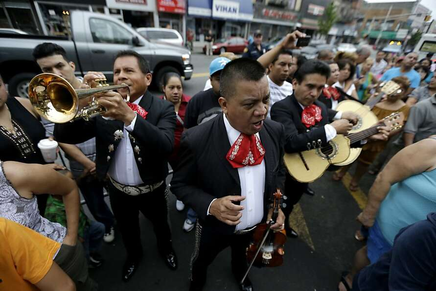 In this July 15, 2012 photo, a Mariachi band serenades the Virgin of Guadalupe at a tree where belie