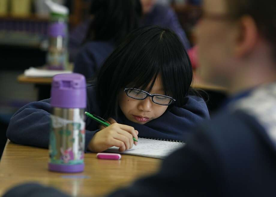 Lillian Tang takes notes in Melissa Thormahlen's 4th and 5th grade class at John Yehall Chin Elementary School in San Francisco, Calif. on Tuesday, Jan. 15, 2013. Photo: Paul Chinn, The Chronicle