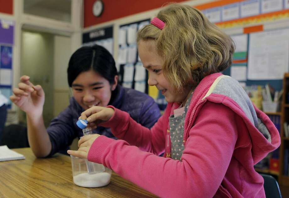 Ema Bajrami (right) and Kelly Lai mix salt and water for a science experiment in Melissa Thormahlen's 4th and 5th grade class at John Yehall Chin Elementary School in San Francisco, Calif. on Tuesday, Jan. 15, 2013. Photo: Paul Chinn, The Chronicle