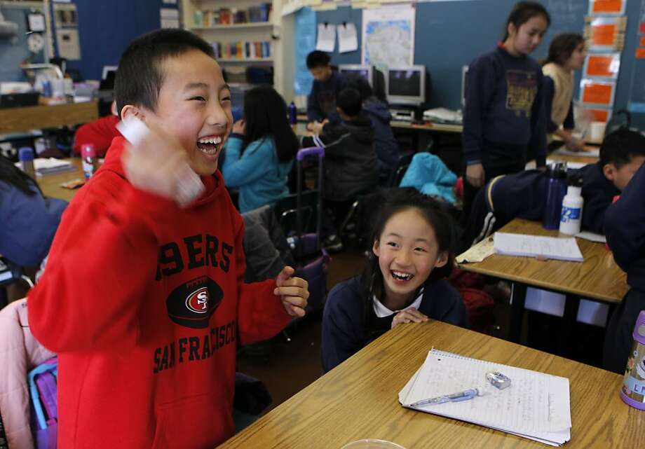 Anita Liu (right) ducks for cover while Otto Gin vigorously mixes salt and water for a science experiment in Melissa Thormahlen's 4th and 5th grade class at John Yehall Chin Elementary School in San Francisco, Calif. on Tuesday, Jan. 15, 2013. Photo: Paul Chinn, The Chronicle