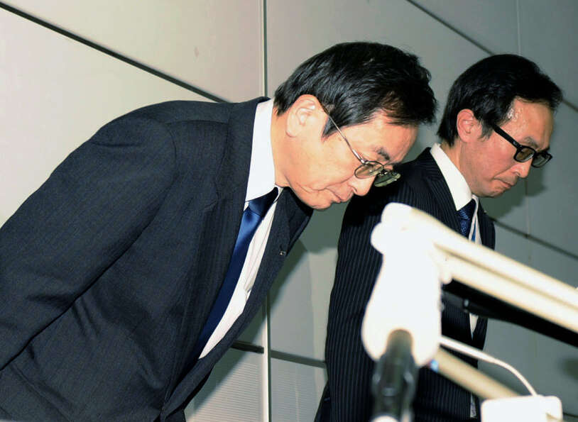 All Nippon Airways Vice President Osamu Shinobe, left, bows in apology during a news conference at H