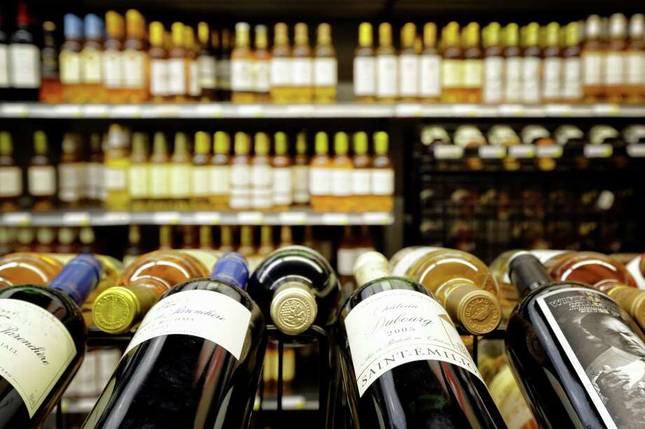 Private customer information, including payment card and check  information, has been exposed at 34 of 155 Spec's wine and liquor  stores, including 20 in the greater Houston area, the company said  Tuesday. Photo: TODD SPOTH, For The Chronicle / © TODD SPOTH, 2012