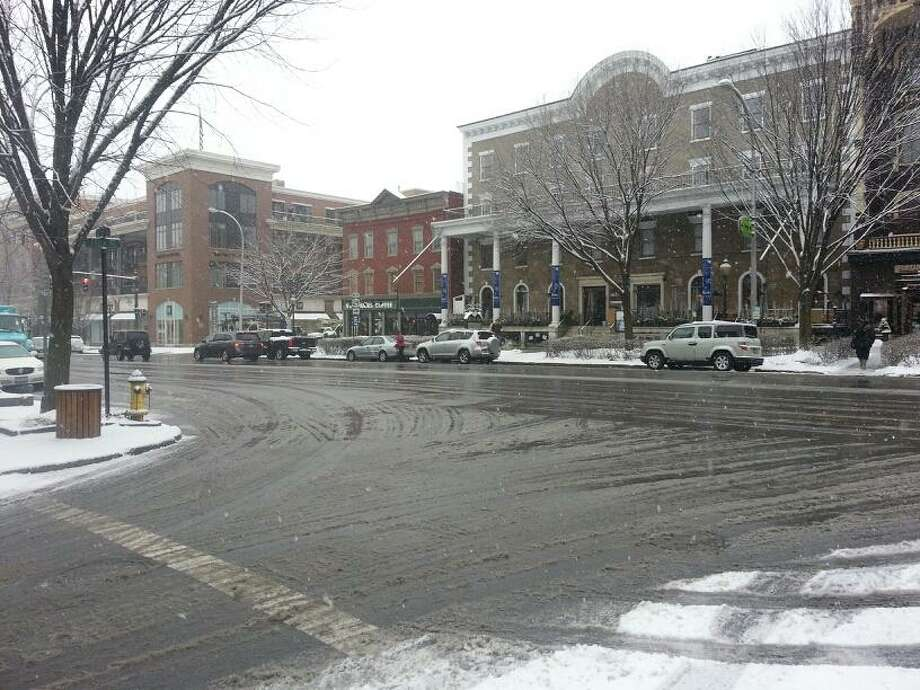 The streets of Saratoga Springs were filled with slush after an overnight snow storm on Wednesday, Jan. 16, 2013. (Dennis Yusko / Times Union)