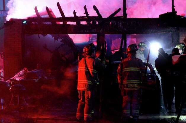San Antonio firefighters work at the scene of a house fire Wednesday January 16, 2013 at the corner of Elmendorf and Woodlawn. Fire Captain Roger Lopez said the fire was probably caused by a malfunctioning heater that was being used to keep some pets warm. Flames erupted at the home about 5:20 a.m. and caused about $200,000 in damage. There were no injuries and the pets appeared to make it out of the home safely. Photo: JOHN DAVENPORT, San Antonio Express-News / ©San Antonio Express-News/Photo Can Be Sold to the Public