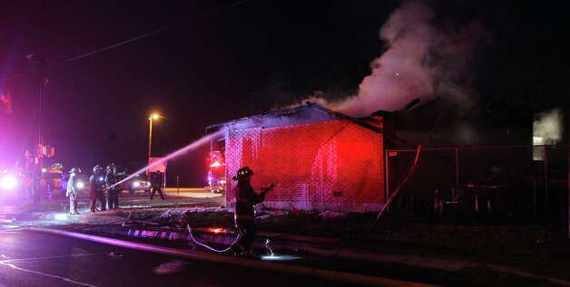 San Antonio firefighters spray water on a single story home Wednesday January 16, 2013 at the corner of Elmendorf and Woodlawn. Fire Captain Roger Lopez said the fire was probably caused by a malfunctioning heater that was being used to keep some pets warm. Flames erupted at the home about 5:20 a.m. and caused about $200,000 in damage. There were no injuries and the pets appeared to make it out of the home safely. Photo: JOHN DAVENPORT, San Antonio Express-News / ©San Antonio Express-News/Photo Can Be Sold to the Public