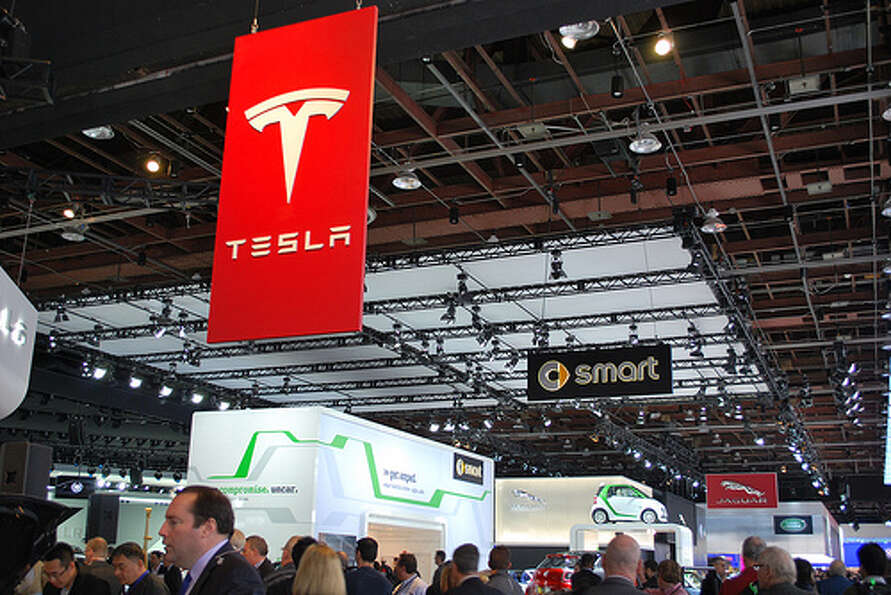Tesla showed off its Model X at the Detroit auto show. The crossover blends elements of an SUV wi