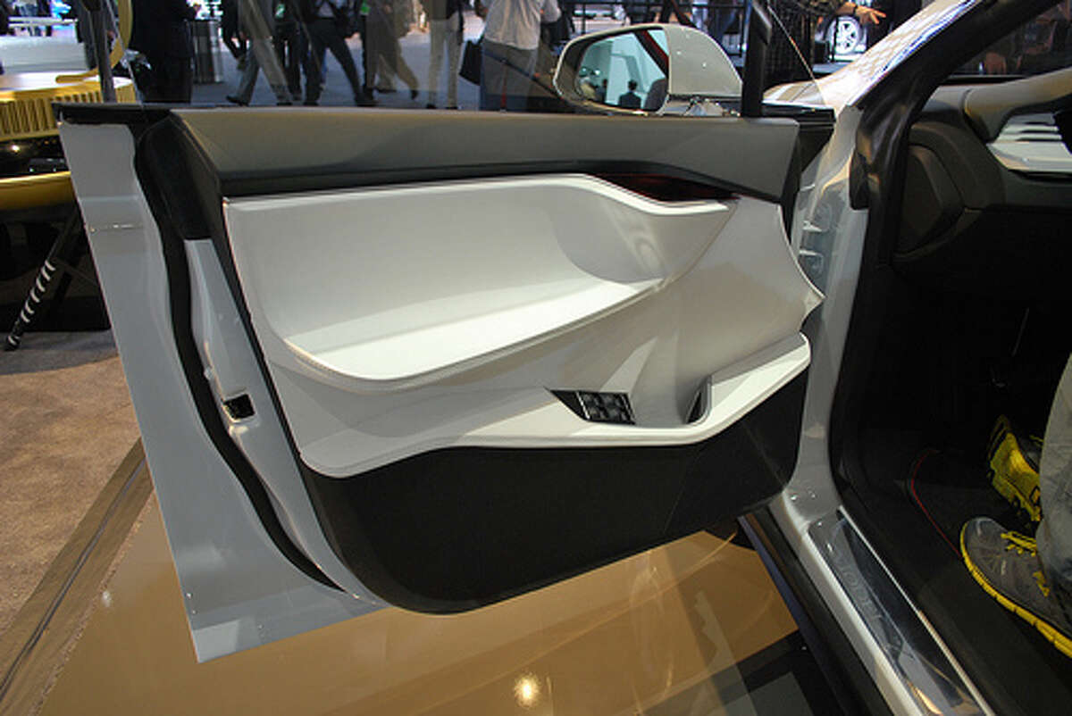 Tesla showed off its Model X at the Detroit auto show. The crossover blends elements of an SUV with the benefits of a minivan. The automaker hopes to begin delivering the SUV in 2014. (Photo: Inhabitat, Flickr)