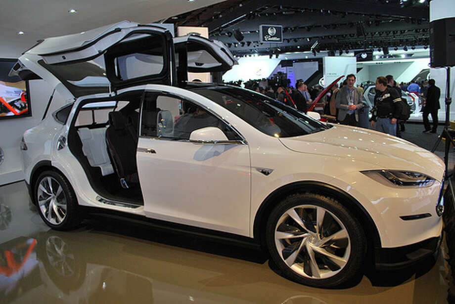 Tesla showed off its Model X at the Detroit auto show. The crossover blends elements of an SUV with the benefits of a minivan. The automaker hopes to begin delivering the SUV in 2014.(Photo: Inhabitat, Flickr) Photo: Inhabitat,  Flickr