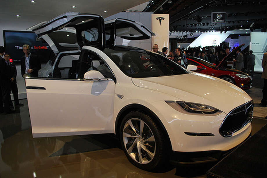 Tesla showed off its Model X at the Detroit auto show. The crossover blends elements of an SUV with the benefits of a minivan. The automaker hopes to begin delivering the SUV in 2014. (Photo: Inhabitat, Flickr) Photo: Inhabitat,  Flickr