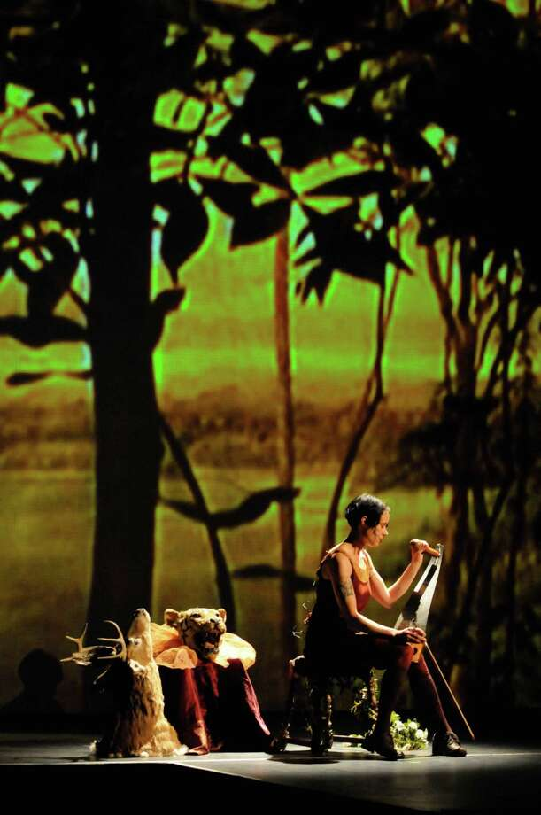 C.Ryder Cooley  plays the saw during her production of XMALIA Songs About Extinction at Proctors Theater in Schenectady,NY Friday July 15,2011.( Michael P. Farrell/Times Union ),C.Ryder Cooley  plays the saw during her production of XMALIA Songs About Extinction at Proctors Theater in Schenectady,NY Friday July 15,2011.( Michael P. Farrell/Times Union ) Photo: Michael P. Farrell, Albany Times Union / 00013894A