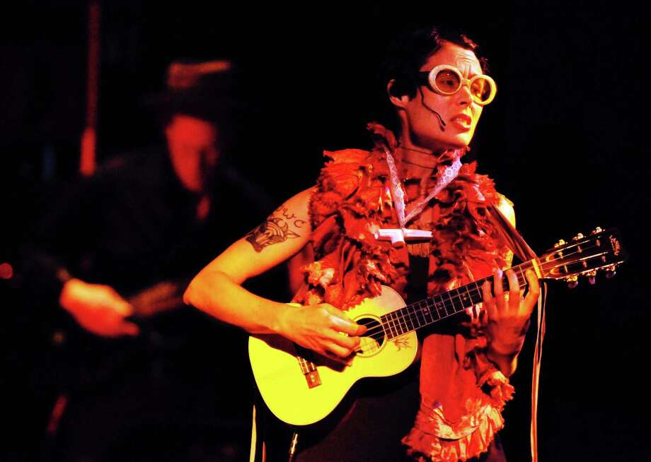 C.Ryder Cooley  plays the ukulele during her production of XMALIA Songs About Extinction at Proctors Theater in Schenectady,NY Friday July 15,2011.( Michael P. Farrell/Times Union ),C.Ryder Cooley  plays the ukulele during her production of XMALIA Songs About Extinction at Proctors Theater in Schenectady,NY Friday July 15,2011.( Michael P. Farrell/Times Union ) Photo: Michael P. Farrell, Albany Times Union / 00013894A