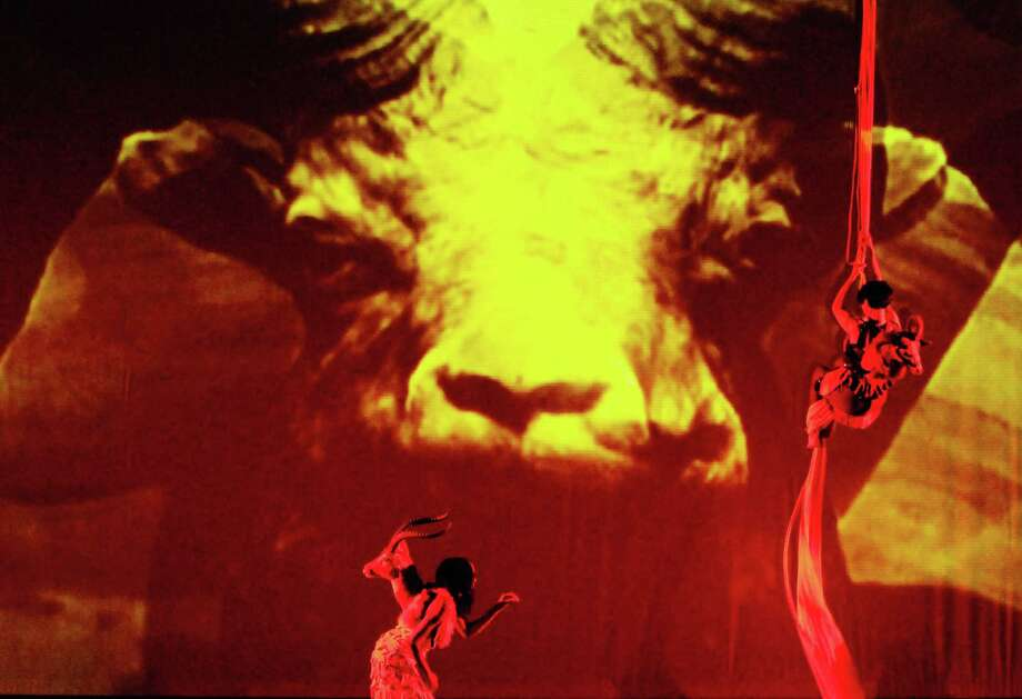 Lady Moon walks the stage  as C.Ryder Cooley climbs during Cooley's production of XMALIA Songs About Extinction at Proctors Theater in Schenectady,NY Friday July 15,2011.( Michael P. Farrell/Times Union ),Lady Moon walks the stage  as C.Ryder Cooley climbs during Cooley's production of XMALIA Songs About Extinction at Proctors Theater in Schenectady,NY Friday July 15,2011.( Michael P. Farrell/Times Union ) Photo: Michael P. Farrell, Albany Times Union / 00013894A