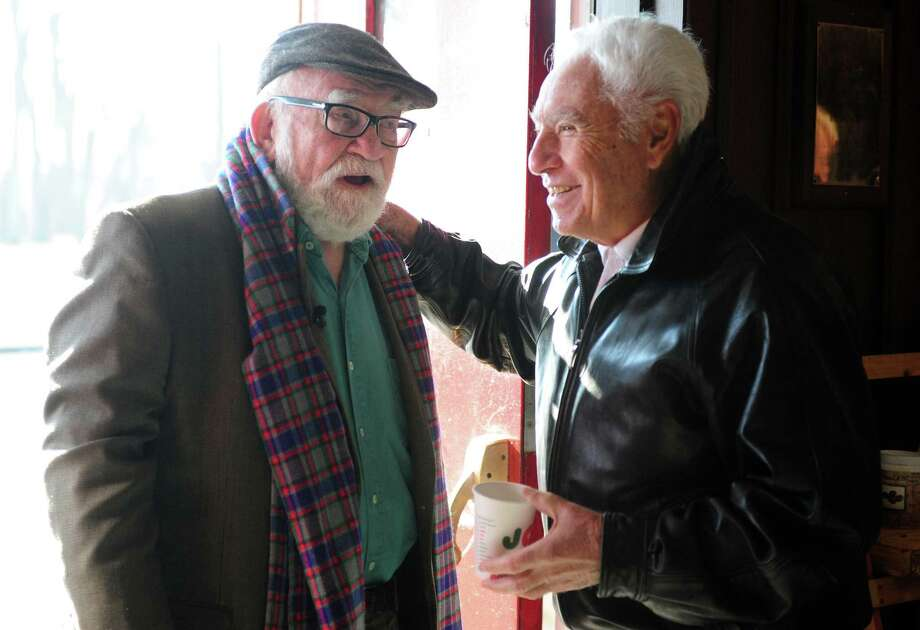 Actor Ed Asner talks with longtime theater carpenter Joe Patria at the American Shakespeare Festival Theatre, where Asner spent a season in 1959, during a visit to Stratford. Photo: Autumn Driscoll / Connecticut Post