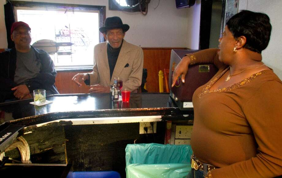 Bartender Denise Tucker talks with customers at Sam Jordan's.