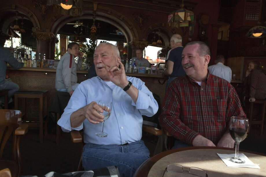 Couple Curt Barton (left) and Art Turmelle (right), both from Fremont talking with patrons at Twin Peaks Tavern in San Francisco Calif.,  on Friday, February 24, 2012.  Curt and Art used to live in the neighborhood and talk about its changes through the years.