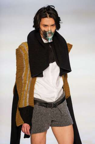 Gentlemen. If you're going somewhere that requires this type of face protection, it's probably also a good idea to protect the upper thighs. A model showcases designs of Au Tim Ying on the runway during the 3rd Knitwear Designers Contest on day 3 of Hong Kong Fashion Week Autumn/Winter 2013 on January 16. Photo: Victor Fraile, Getty Images / 2013 Getty Images