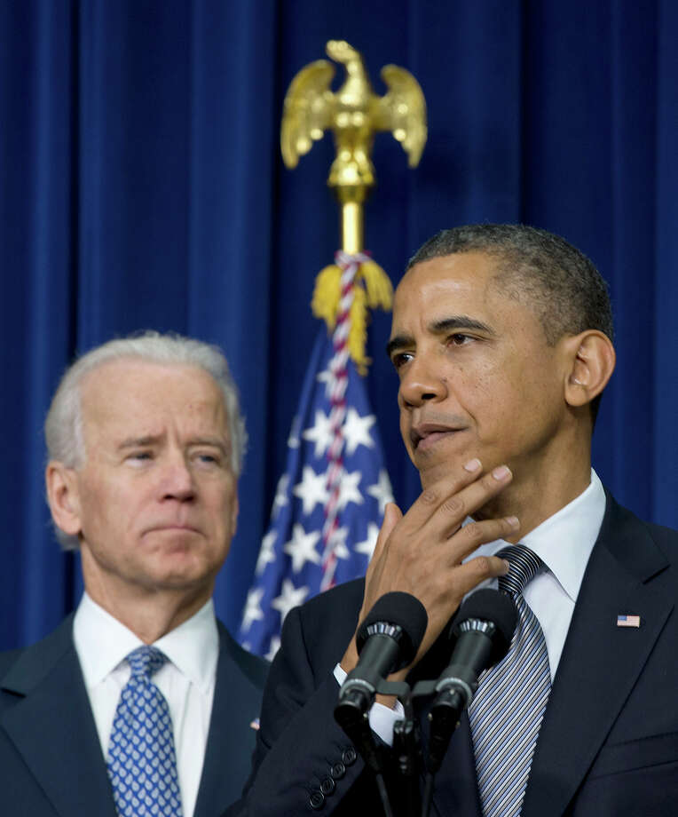 President Barack Obama, accompanied by Vice President Joe Biden, pauses as he talked about proposals to reduce gun violence, Wednesday, Jan. 16, 2013, in the South Court Auditorium at the White House in Washington. Photo: AP