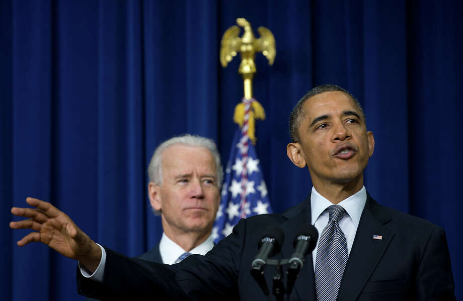 President Barack Obama, accompanied by Vice President Joe Biden, gestures as he talks about proposals to reduce gun violence, Wednesday, Jan. 16, 2013, in the South Court Auditorium at the White House in Washington. Photo: AP
