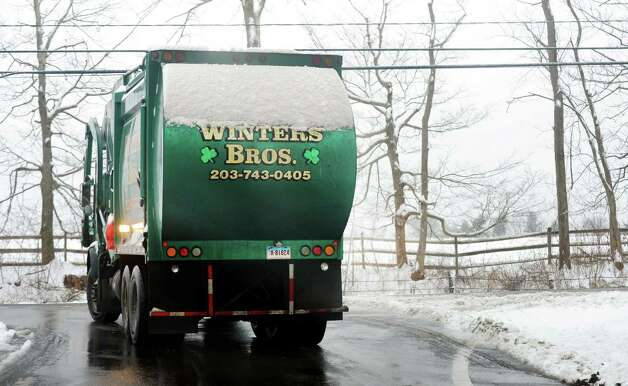 "A ""Winters Bros."" travels through the wintery Redding, Conn. streets on Wednesday, Jan. 16, 2013 after an overnight snowfall blanketed the area. Photo: Cathy Zuraw / The News-Times"