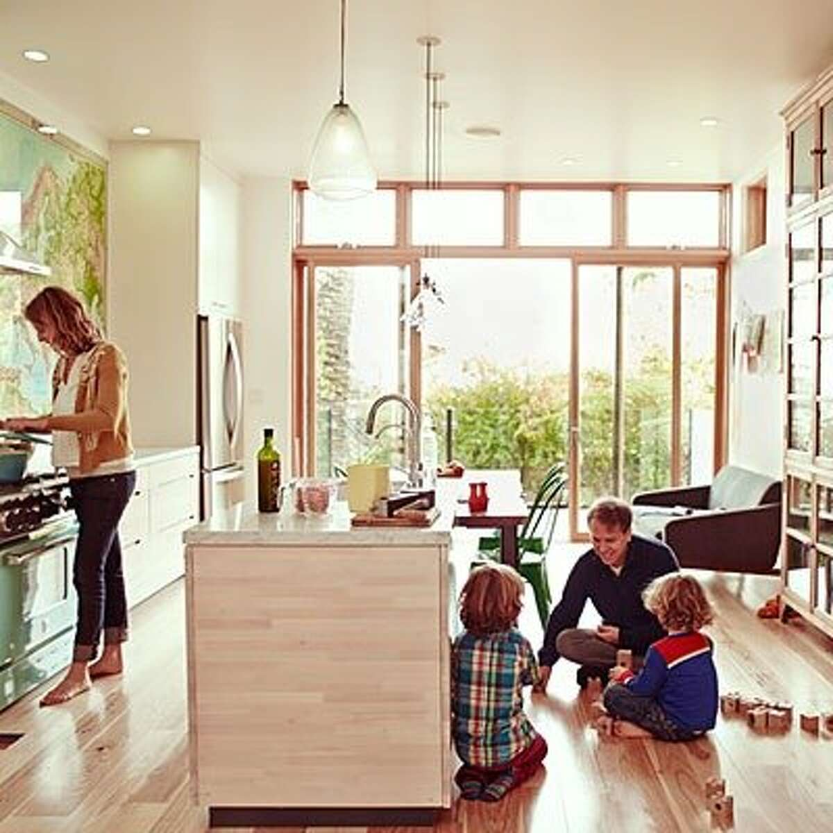 Modern meets old-school: Modern lines and electricity are present in the kitchen, but there are no digital interfaces on those shiny appliances. On the floor, the kids play with toys like wood blocks, not video games. Read more: The unplugged home