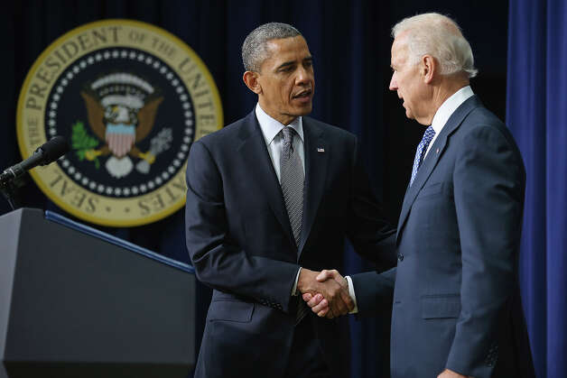U.S. President Barack Obama and Vice President Joe Biden announce the administration's new gun law proposals in the Eisenhower Executive Office building January 16, 2013 in Washington, DC. One month after a massacre that left 20 school children and 6 adults dead in Newtown, Connecticut, the president unveiled a package of gun control proposals that include universal background checks and bans on assault weapons and high-capacity magazines. Photo: Chip Somodevilla, Getty Images / 2013 Getty Images