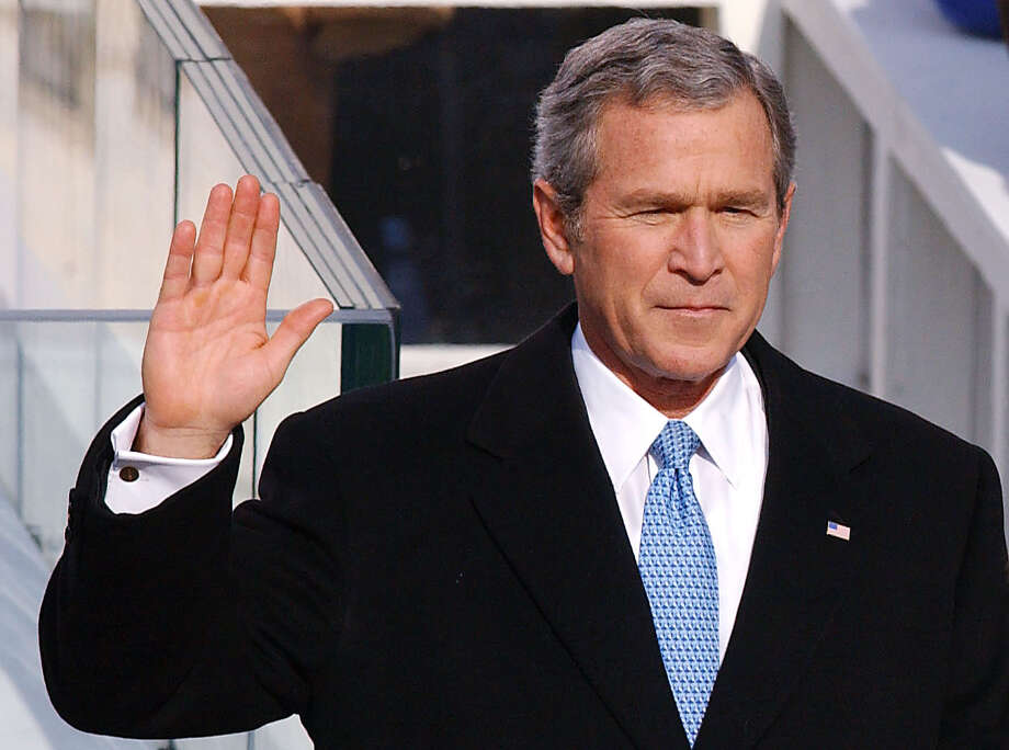 "George W. Bush used a family Bible, open to Isaiah 40:31, during his 2005 swearing-in. For the 2001 inauguration, Bush used a family Bible that was closed. ""But those who wait on the Lord Shall renew their strength; They shall mount up with wings like eagles, They shall run and not be weary, They shall walk and not faint.""  Photo: NICOLAS KHAYAT, KRT / ABACA PRESS"