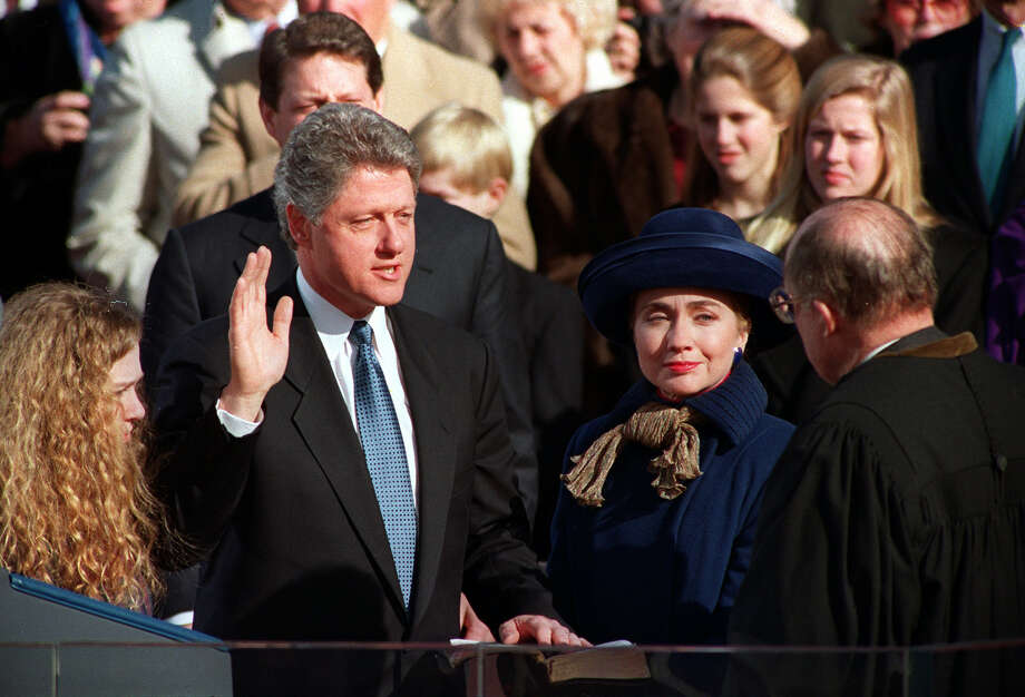 """Bill Clinton use a King James Bible given to him by his grandmother for both inaugurations. In 1993, the Bible was open to Galatians 6:8. In 1997, the Bible was open to Isaiah 58:12. Galatians 6:8""""For he that sows to his flesh shall of the flesh reap corruption; but he that sows to the Spirit shall of the Spirit reap life everlasting.""""Isaiah 58:12""""Those from among you Shall build the old waste places; You shall raise up the foundations of many generations; And you shall be called the Repairer of the Breach, The Restorer of Streets to Dwell In."""" Photo: ED REINKE, AP / AP"""