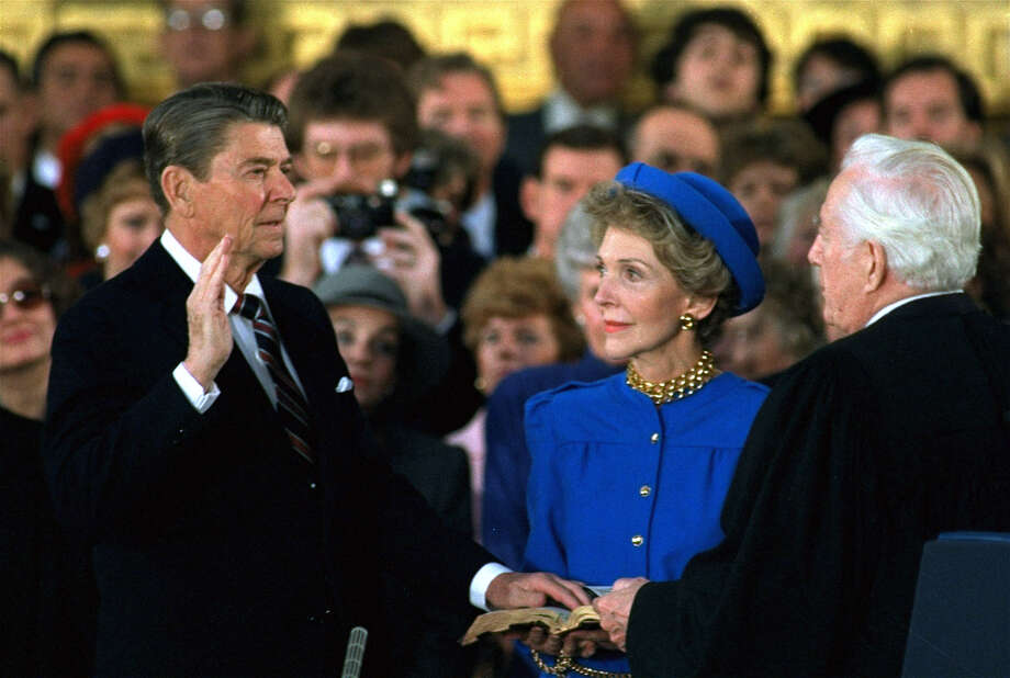 "Ronald Reagan used a family Bible given to him by his mother for both inauguration ceremonies. In both 1981 and 1985, the Bible was open to II Chronicles 7:14. ""if My people who are called by My name will humble themselves, and pray and seek My face, and turn from their wicked ways, then I will hear from heaven, and will forgive their sin and heal their land."" Photo: RON EDMONDS, AP / AP"