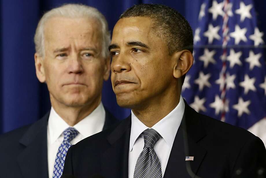 President Barack Obama, accompanied by Vice President  Joe Biden, talks about proposals to reduce gun violence, Wednesday, Jan. 16, 2013, in the South Court Auditorium at the White House in Washington. (AP Photo/Charles Dharapak) Photo: Charles Dharapak, Associated Press