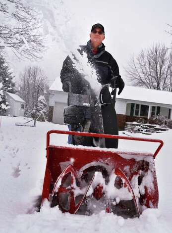Ken Speanburg clears the driveway at his Clifton Park home Wednesday morning Jan. 16, 2013. (John Carl D'Annibale / Times Union) Photo: John Carl D'Annibale / 00020789A