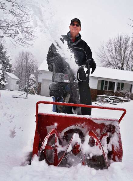 Ken Speanburg clears the driveway at his Clifton Park home Wednesday morning Jan. 16, 2013. (John Ca