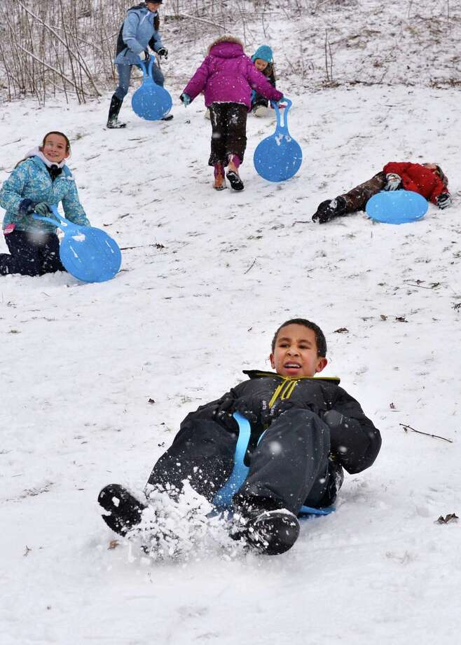 Waldorf School fifth grader Shaun Wiggins sleds with classmates during a class outing to High Rock Park, Wednesday morning Jan. 16, 2013, in Saratoga Springs, N.Y.  (John Carl D'Annibale / Times Union) Photo: John Carl D'Annibale / 00020789A