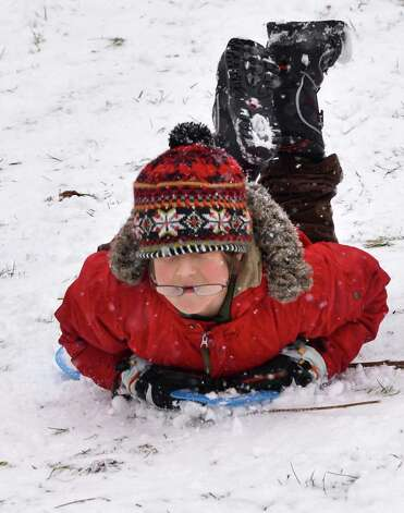 Waldorf School fifth grader Trek Bjelica sleds with classmates during a class outing to High Rock Park,  Wednesday morning Jan. 16, 2013,  in Saratoga Springs, N.Y. (John Carl D'Annibale / Times Union) Photo: John Carl D'Annibale / 00020789A