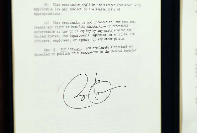 President Barack Obama signature appears on one of several executive orders he signed as part of the administration's new gun law proposals in the Eisenhower Executive Office building January 16, 2013 in Washington, DC. One month after a massacre that left 20 school children and 6 adults dead in Newtown, Connecticut, the president unveiled a package of gun control proposals that include universal background checks and bans on assault weapons and high-capacity magazines. Photo: Chip Somodevilla, Getty Images / 2013 Getty Images