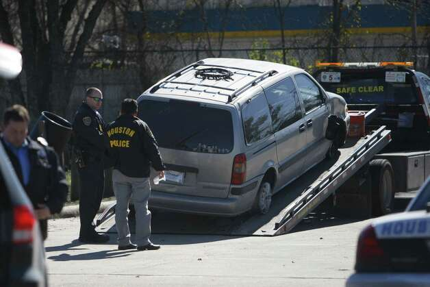 Tow driver loads up a van involved in a police chase Wednesday, Jan. 16, 2013. Photo: Cody Duty / Houston Chronicle
