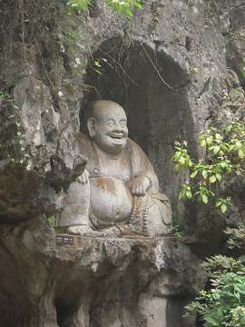 A laughing Buddha in a cliff in Suzhou, China.