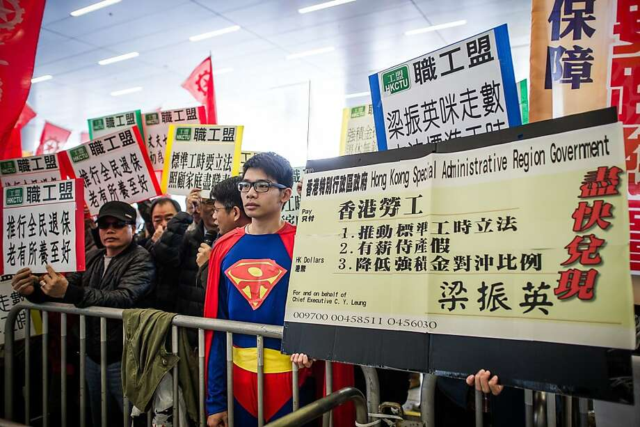 Super disappointment:The Boy of Steel joins a protest against Hong Kong Chief Executive Leung Chun-ying. Leung won office after campaigning on promises to improve the lives of the poor and middle class, which many feel he hasn't delivered upon. Photo: Philippe Lopez, AFP/Getty Images