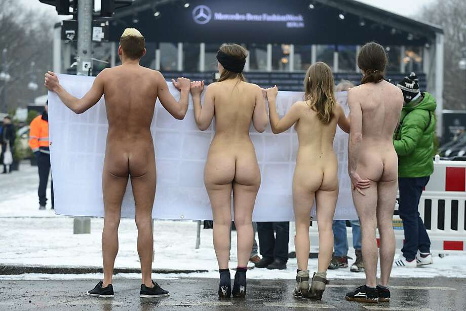 Crack down on fashion fur! Animal-rights activists strip to their sneakers outside the catwalk hall of Berlin Fashion Week to protest the show's use of real fur. Photo: John MacDougall, AFP/Getty Images