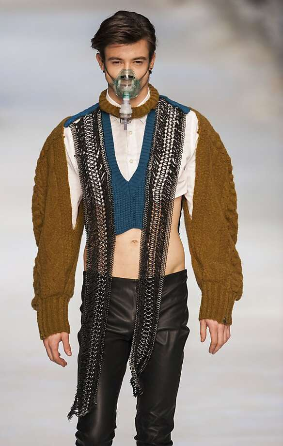 Like to wear sweaters even when it's hot?Enjoy showing off your midriff? Suffering from emphysema? Then this outfit at Hong Kong Fashion Week is for you! Photo: Victor Fraile, Getty Images