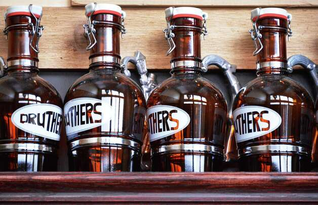 Growlers at Druthers Brewing Company in Saratoga Springs Tuesday Jan. 15, 2013.   (John Carl D'Annibale / Times Union) Photo: John Carl D'Annibale / 00020754A